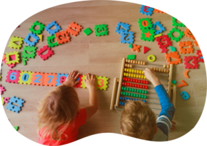 Kids on Floor With Puzzle