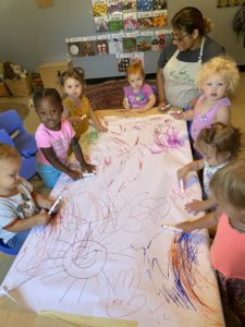 Kids coloring on table