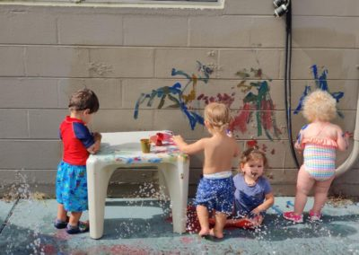Kids with paint and water