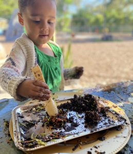girl playing with dirt
